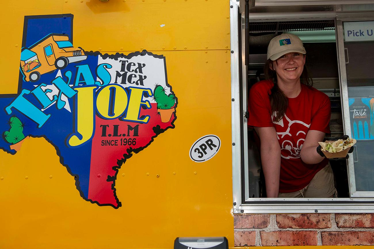 Tiffany from Texas Joe food truck serves up the chicken and beef tacos / Image: Joe Simon // Published: 5.26.19