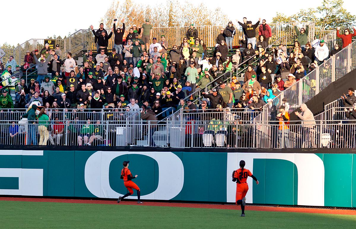The Oregon State Beavers outfielders watch helplessly as Mia Camuso (#7) hits a walk-off grand slam. The Oregon Ducks defeated the Oregon State Beavers 8-0 in game one of the three-game Civil War series on Friday night at Jane Sanders Stadium. The game was 0-0 until Gwen Svekis (#21) hit a solo homerun in the fourth inning. Mia Camuso hit a grand slam in the fifth inning, ending the game for the Ducks by mercy rule. Photo by Dan Morrison