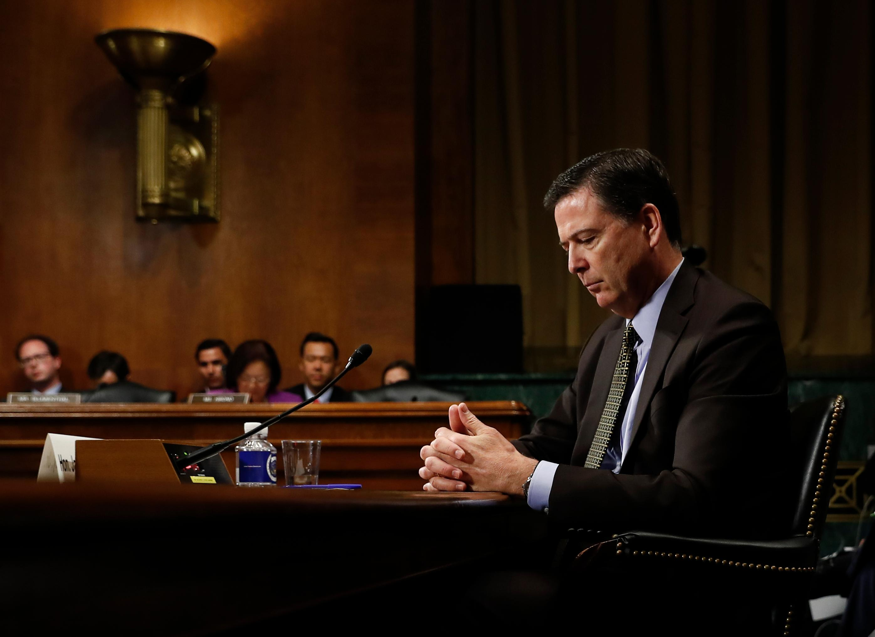 In this Wednesday, May 3, 2017, photo then-FBI Director James Comey pauses as he testifies on Capitol Hill in Washington, before a Senate Judiciary Committee hearing. President Donald Trump abruptly fired Comey on May 9, ousting the nation's top law enforcement official in the midst of an investigation into whether Trump's campaign had ties to Russia's election meddling.(AP Photo/Carolyn Kaster)