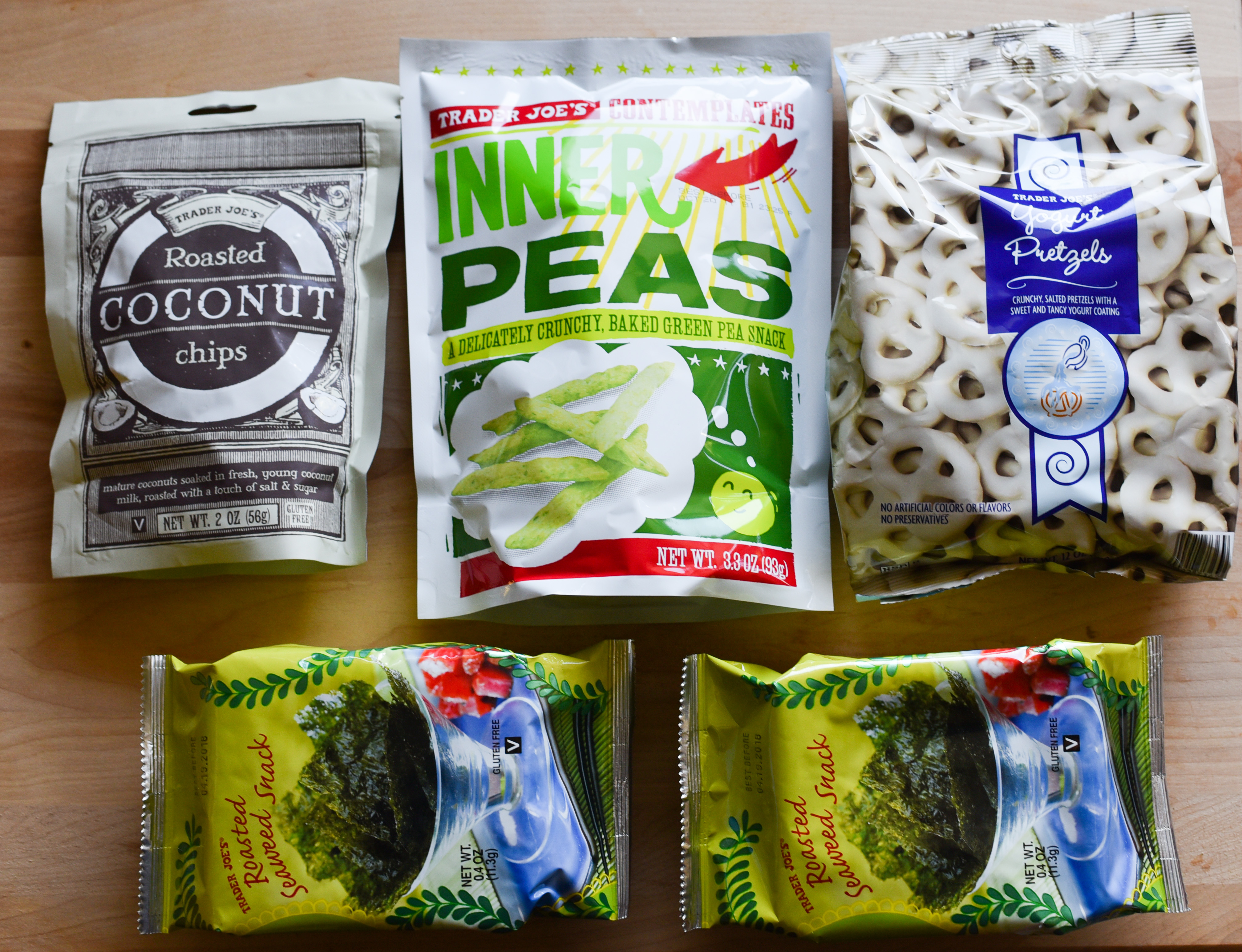 Sometimes you need a crunchy snack while on a long trip but don't want to sacrifice nutrition. Luckily there are some awesome options out there. Grab some coconut chips if you want a slightly sweet crunch or dried peas for a saltier crunch. Yogurt covered pretzels are a great combination of sweet and salty. Dried seaweed is an great choice for a nutritious salty snack.  (Image: Rebecca Mongrain/Seattle Refined)