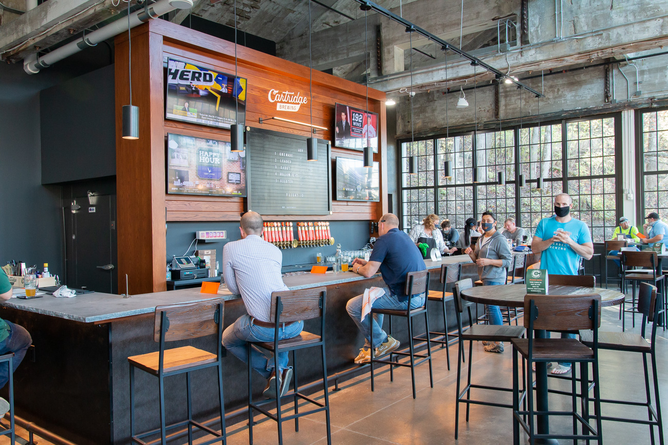 The interior of the taproom, dining room, and conversation areas were designed by Platte Architecture and Design to include nods to the Powder Factory's history whenever possible. / Image: Elizabeth A. Lowry // Published: 11.25.20