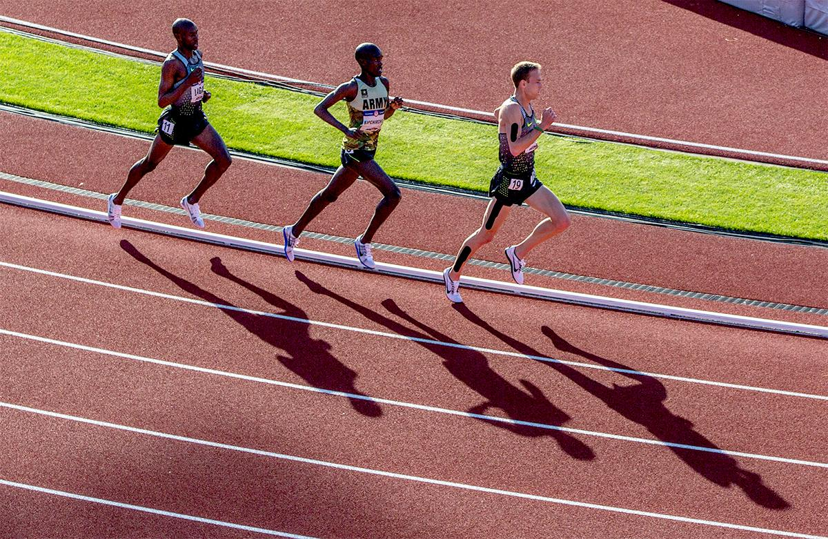 Nike Oregon Project's Galen Rupp leads U.S. Army's Shadrack Kipchirchir and Nike's Bernard Lagat around the corner in the 10,000 meters. Rupp won the race with a time of 27:55.04. Day one of the U.S. Olympic Trials Track and Field began on Friday at Hayward Field in Eugene, Oregon and will continue through July 10. Photo by August Frank, Oregon News Lab