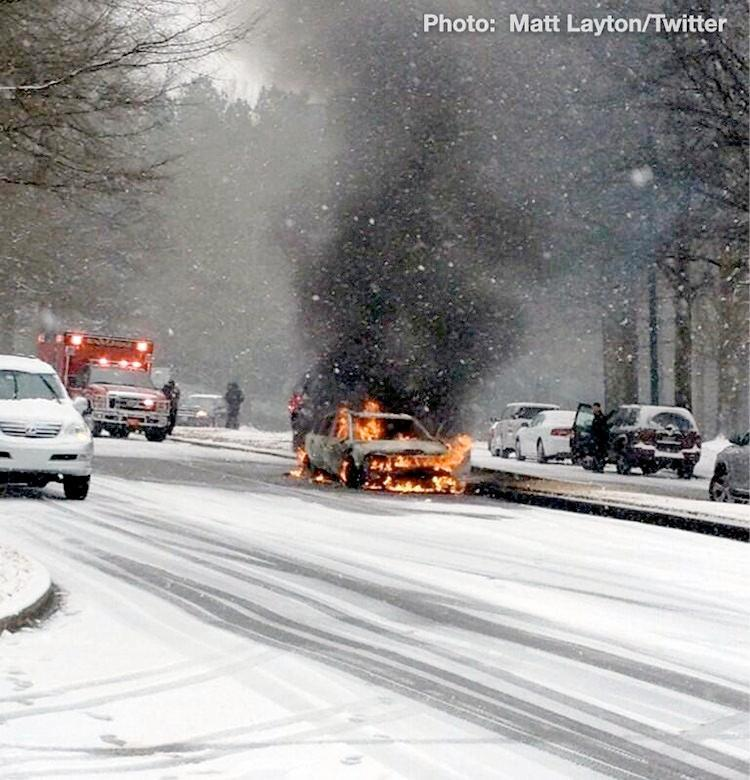 A car in Birmingham was destroyed by fire during a winter storm in Alabama, Tuesday, January 28, 2014.