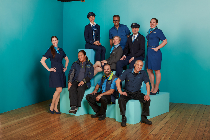 Employees from Alaska Airlines' regional partner Horizon Air show off the range of new uniform pieces. The Horizon collection complements Alaska Airlines uniform collection and includes signature scarves and wings for Horizon's uniformed employees. (Photo: Alaska Airlines)