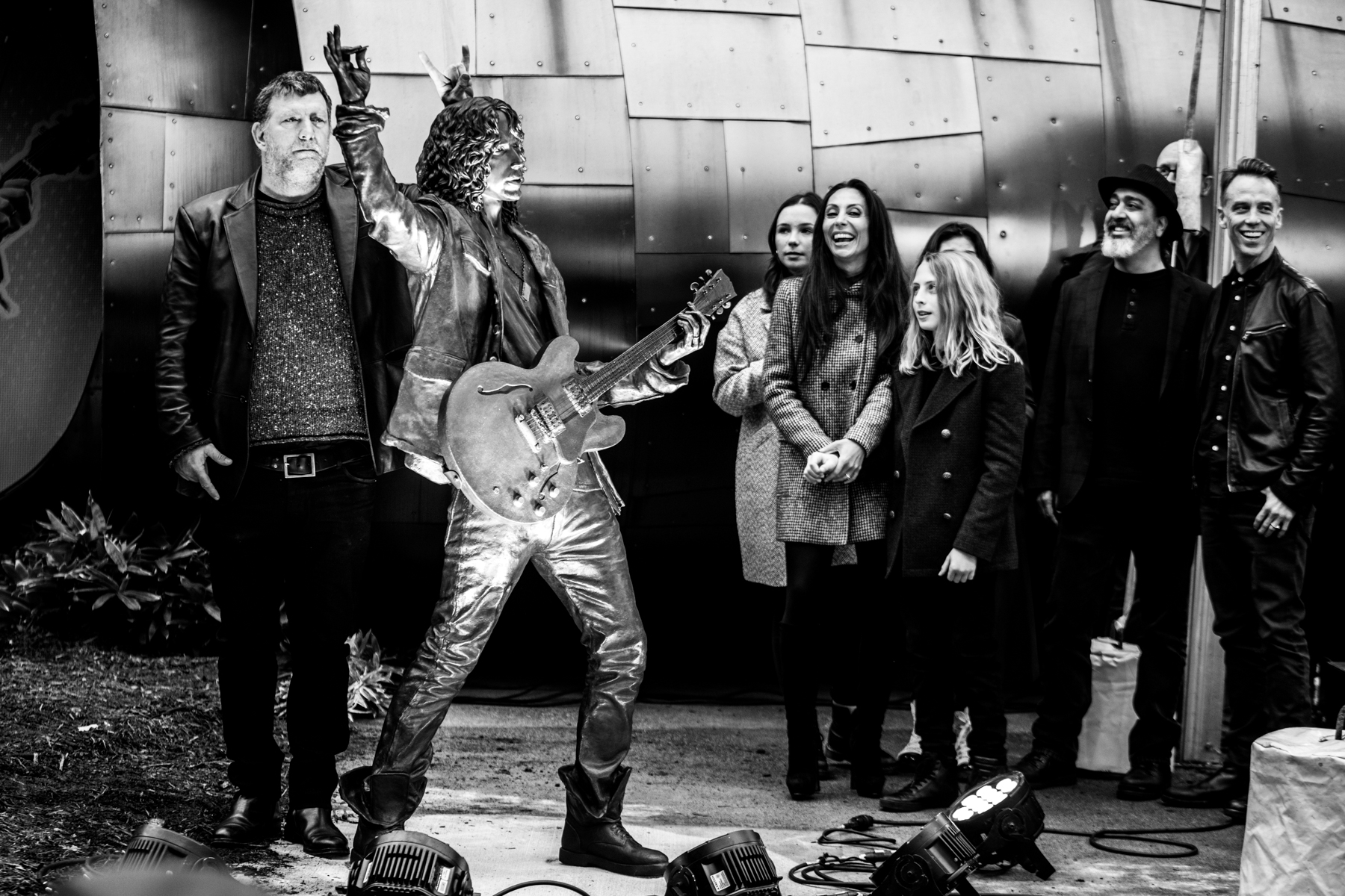 Throngs of rock fans attended the official unveiling of the commemorative statue of the late legend, Chris Cornell, yesterday evening at the Museum of Pop Culture. In attendance were Cornell's family, bandmates, Mayor Durkan and more (Image: Chona Kasinger / Seattle Refined).