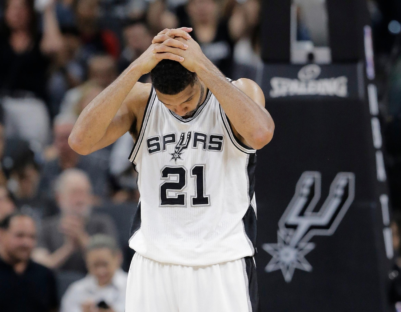 San Antonio Spurs forward Tim Duncan holds his hands over his head after a play during the second half in Game 5 of the team's second-round NBA basketball playoff series against the Oklahoma City Thunder, Tuesday, May 10, 2016, in San Antonio. Oklahoma City won 95-91. (AP Photo/Eric Gay)