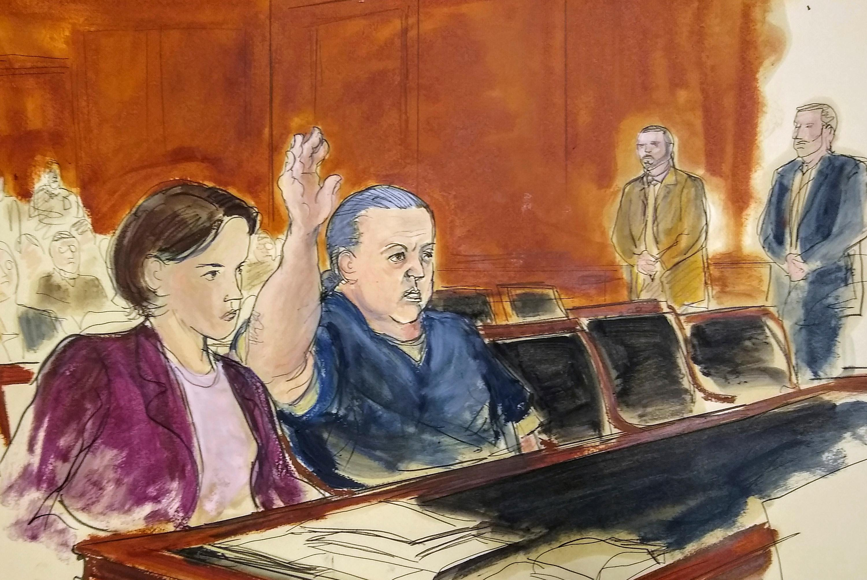 FILE- This Nov. 6, 2018 file courtroom sketch, pipe bomb suspect Cesar Sayoc raises his arm to swear to the truth of his statement of need for assigned counsel, during his presentment in Manhattan Federal Court in New York. he Florida man who authorities say sent pipe bombs to prominent critics of President Donald Trump, is expected to plead guilty in Manhattan federal court on Thursday, March 21, 2019. (Elizabeth Williams via AP)