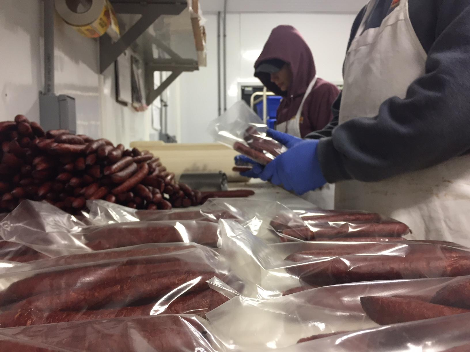 Workers process the meat for distribution at Smokey Meats in Crivitz, November 18, 2017, (WLUK/Lauren Kalil)<p></p>