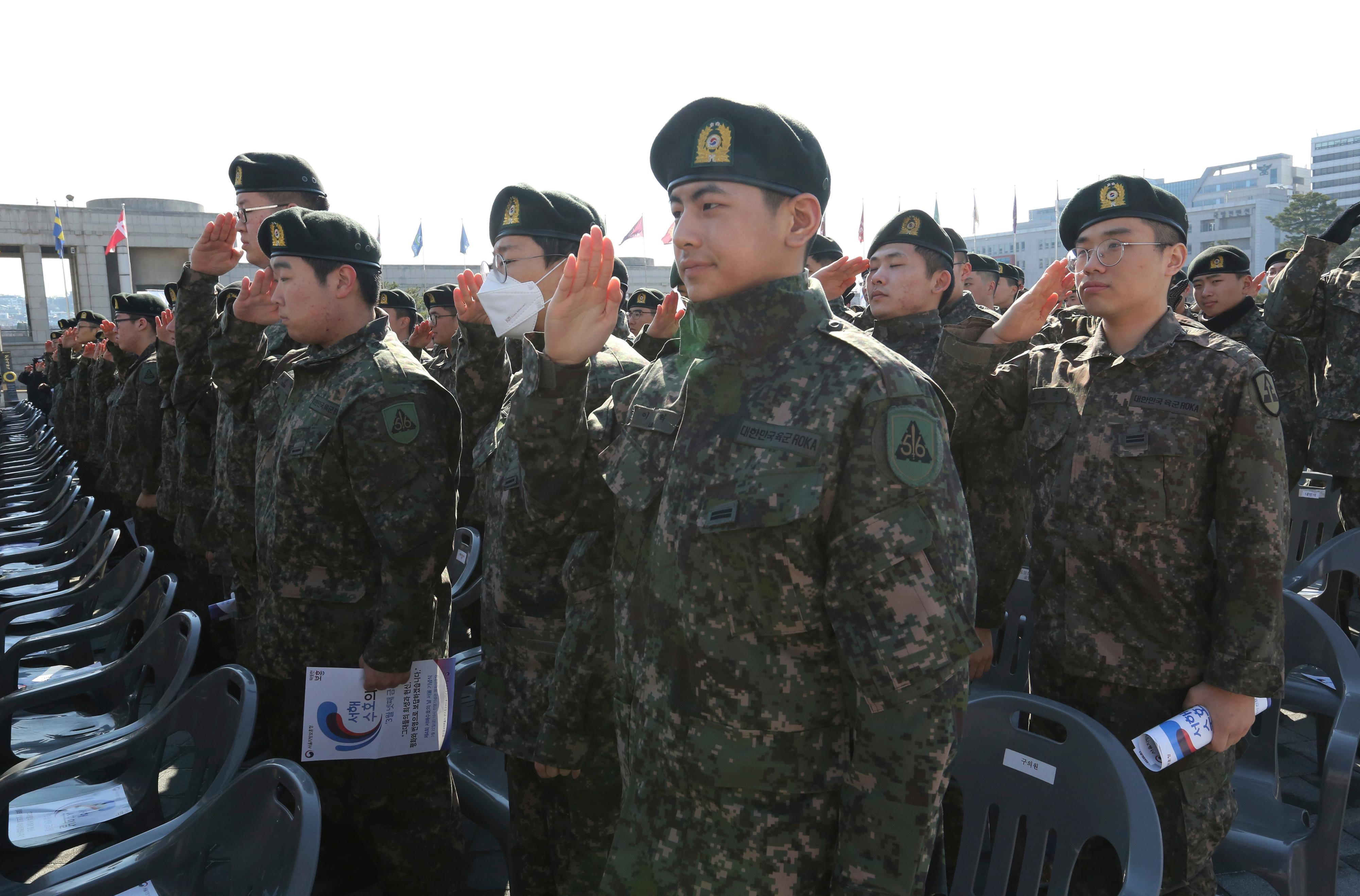 South Korean army soldiers salute during a ceremony to commemorate South Korean soldiers killed in three major clashes with North Korea in the West Sea, in Seoul, South Korea, Friday, March 22, 2019.{ } (AP Photo/Ahn Young-joon)