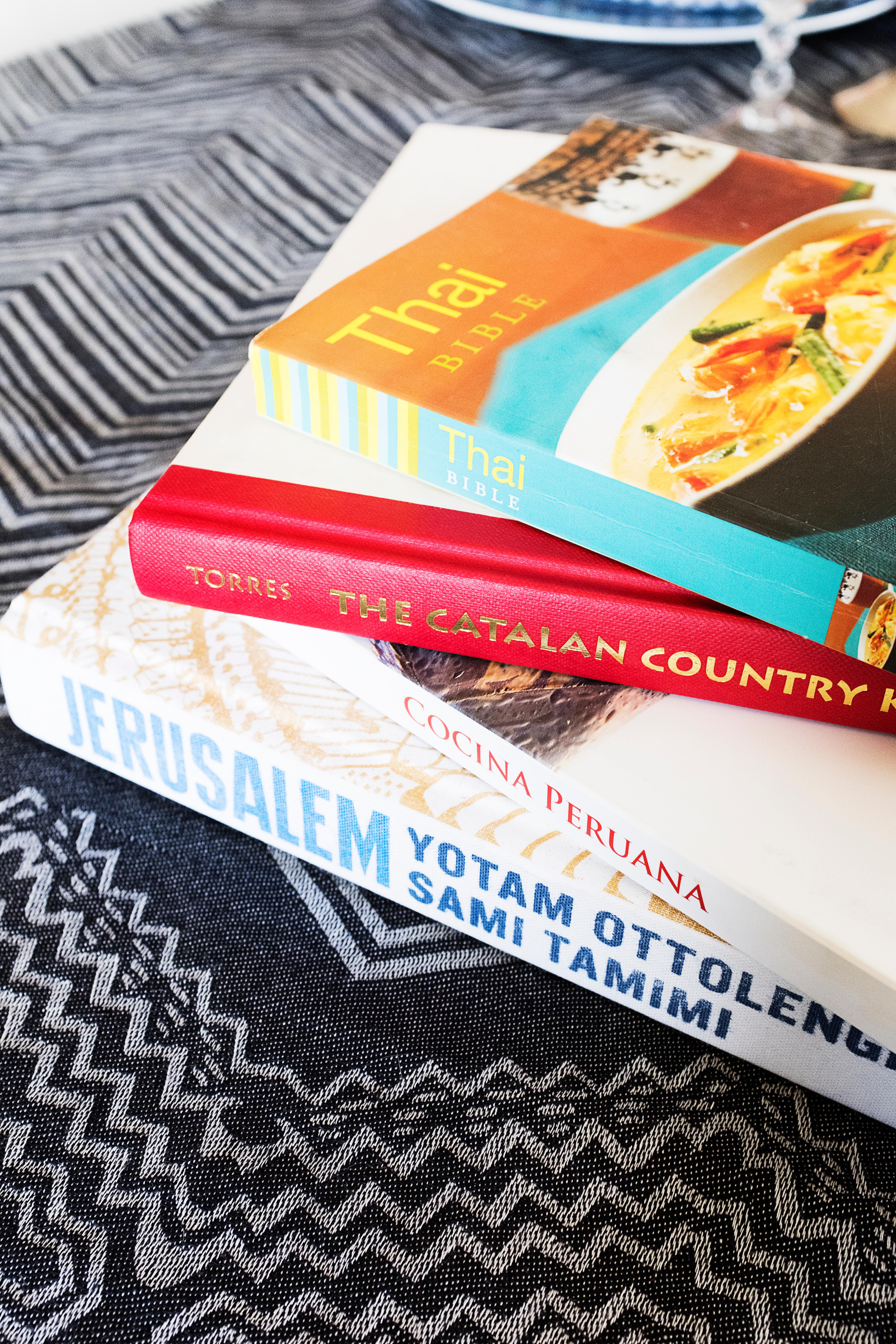 Plan a multi-course meal from a variety of your favorite cookbooks from around the world. But don't fret about preparing an elaborate meal, as it does not have to be fancy or hard. Choose dishes that you are inspired by your travels and that fit your comfort level of cooking. (Image: Ashley Hafstead)