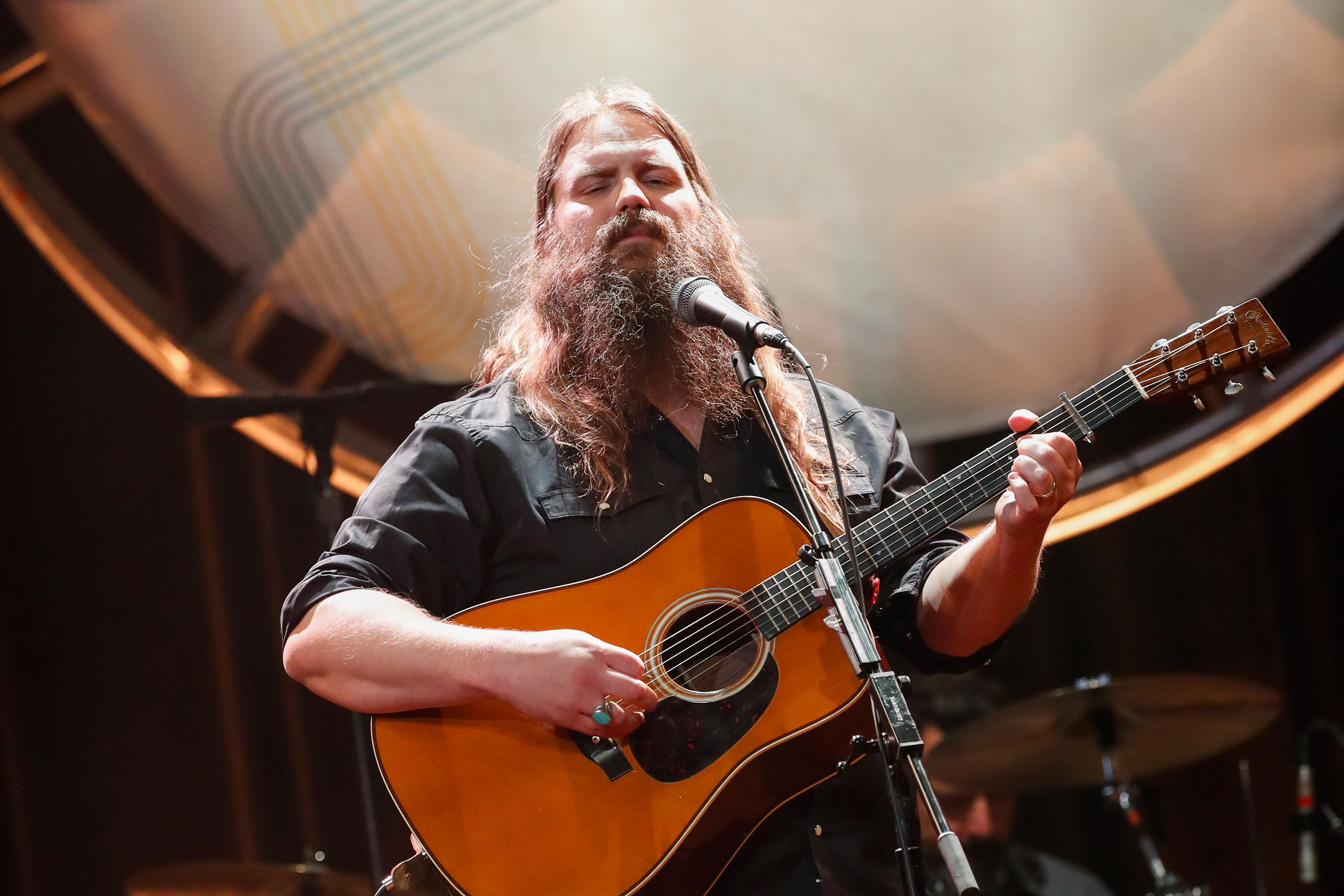"FILE - In this Aug. 22, 2018, file photo, Chris Stapleton performs at the 12th Annual ACM Honors at the Ryman Auditorium in Nashville, Tenn. Stapleton tops the list of finalists with five nominations for the 52nd annual Country Music Association Awards. The nominations were announced Tuesday, Aug. 28, from entertainer Luke Bryan's restaurant and bar in Nashville on ABC's ""Good Morning America."" (Photo by Al Wagner/Invision/AP, File)"
