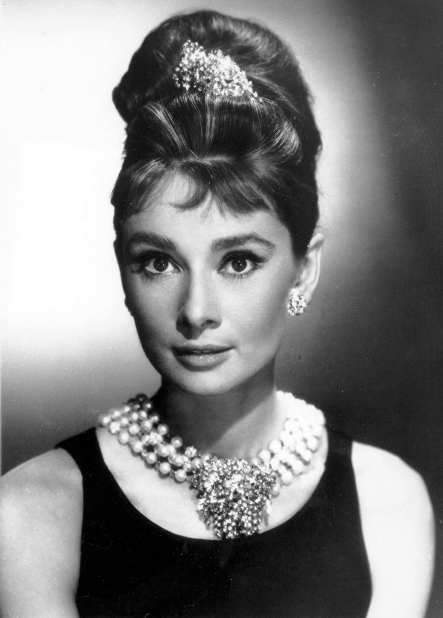 "FILE - In this undated file photo, actress Audrey Hepburn poses as Holly Golightly in the 1961 movie ""Breakfast at Tiffany's."" The New York-based jewelry retailer opened a restaurant at its flagship store on 5th Ave. in New York City and the menu does include breakfast. (AP Photo, File)"