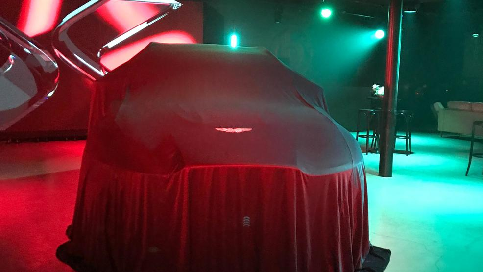 Aston Martin DBX under wraps photo by Jill Ciminillo.JPG