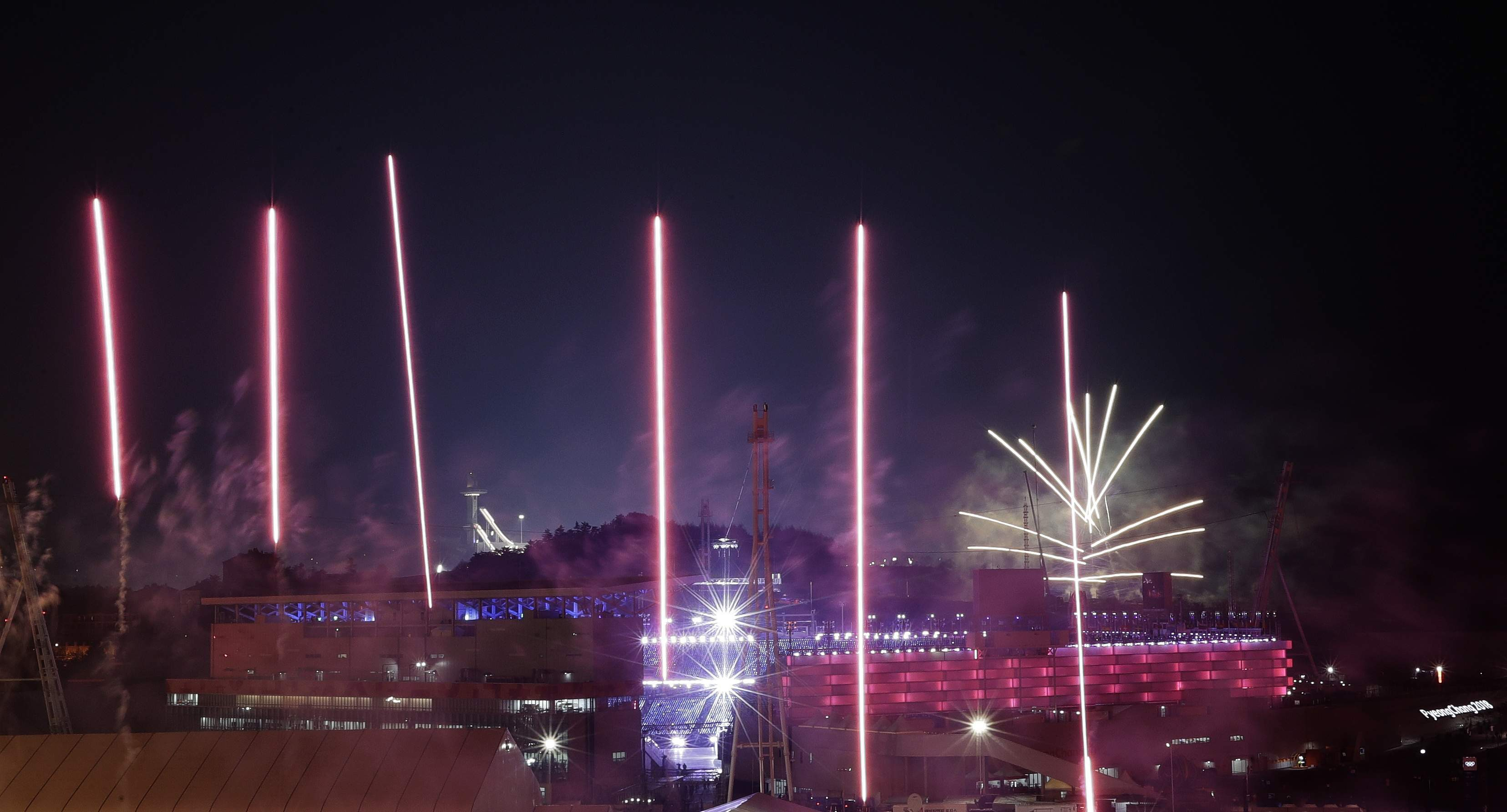 Fireworks explode around the Olympic Stadium to mark the start of the opening ceremony at the 2018 Winter Olympics in Pyeongchang, South Korea, Friday, Feb. 9, 2018. (AP Photo/Kirsty Wigglesworth)