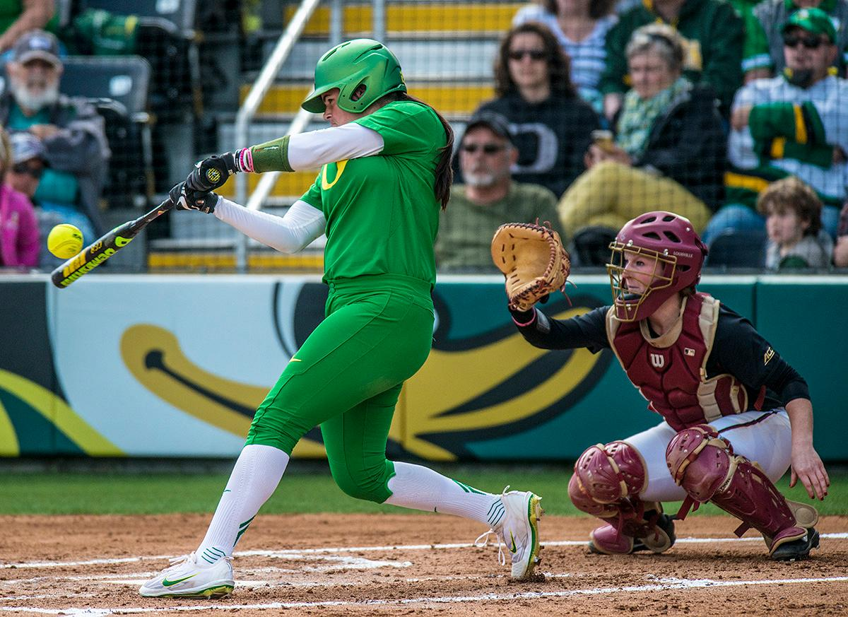 Oregon Ducks catcher Gwen Svekis (#21) attempts to hit the ball. The No. 5 Oregon Ducks defeated the No. 2 Florida State Seminoles in both games of the doubleheader (11-0, 3-1) on Saturday afternoon. This sweep of the first two rounds of the postseason happened in front of a soldout crowd of 2,517 at Jane Sanders Stadium. Photo by Rhianna Gelhart, Oregon News Lab