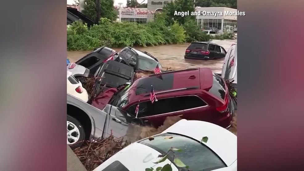 Nj flood sweeps cars away from dealership wbff for Jeep dealer colorado springs motor city