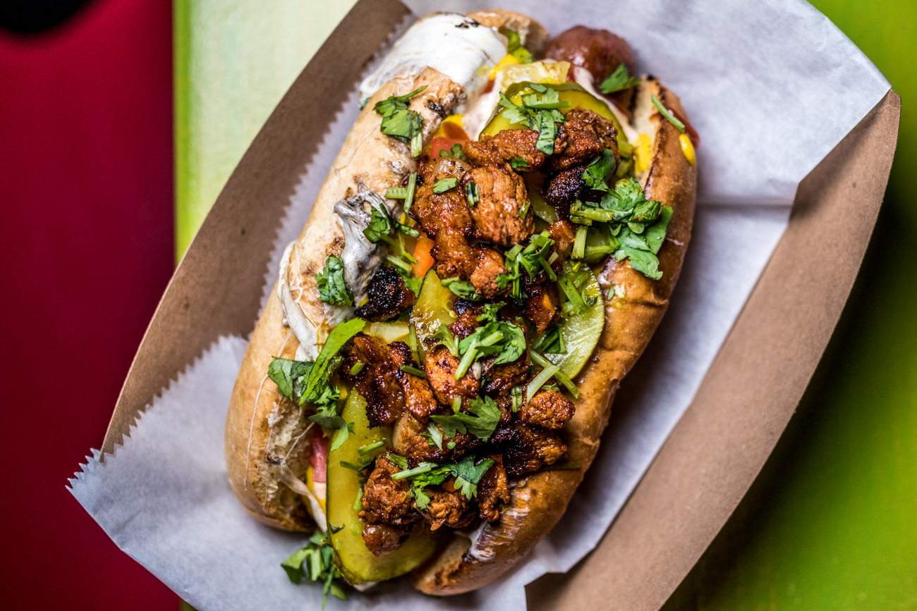 Al Pastor Papi Jochos: Papi's all-beef hot dog, grilled onions, grilled pastor pork, queso oaxaca, pineapple salsa, ketchup, mustard, mayo, tomato, house pickles, cotija, and cilnatro / Image: Catherine Viox // Published: 8.24.20