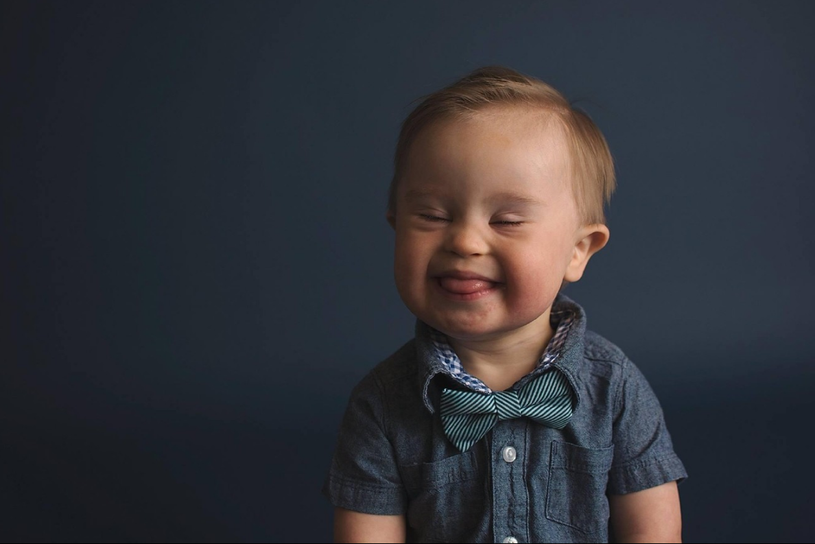Boy with Down syndrome appears in Oshkosh ad after being dismissed by agency (Photos: Meagan Nash and Crystal Barbee Photograph / crystalbarbeephotography.com)