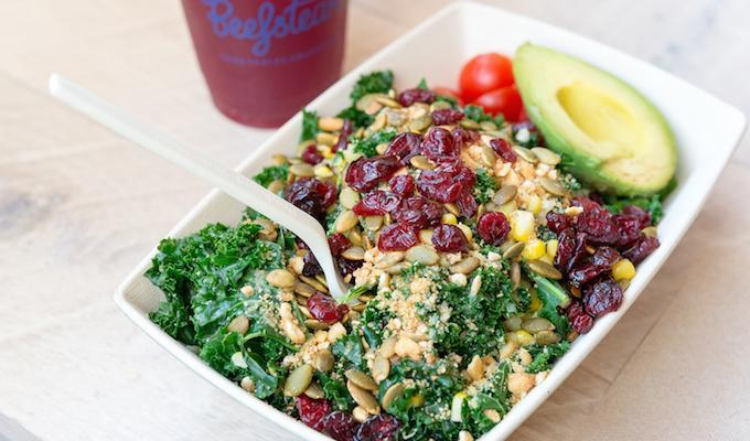 Beefsteak's Frida Kale salad is a surprisingly delicious blend of kale, cranberries, black beans and a spicy tomato sauce. (Photo by Rey Lopez)<p></p>