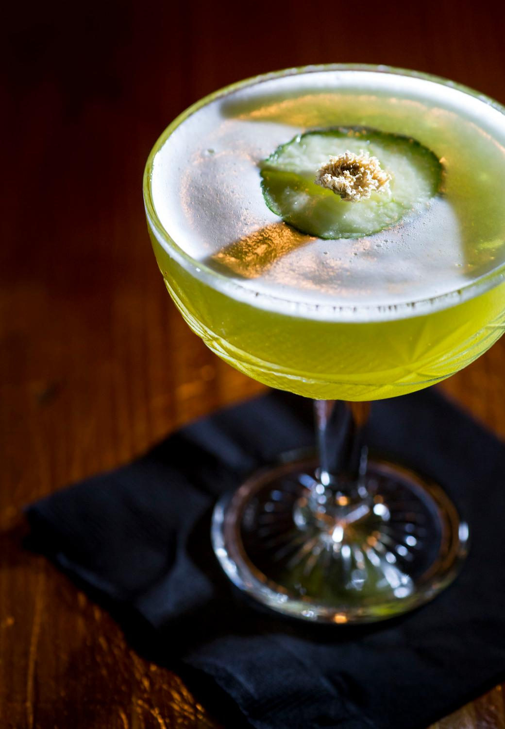 """Ze Lilypad"" - Vodka, green chartreuse, house kiwi syrup, house grapefruit shrub. Garnish is a dried Chrysanthamum flower atop a cucumber to have the look of a Lilypad. (Sy Bean / Seattle Refined)"