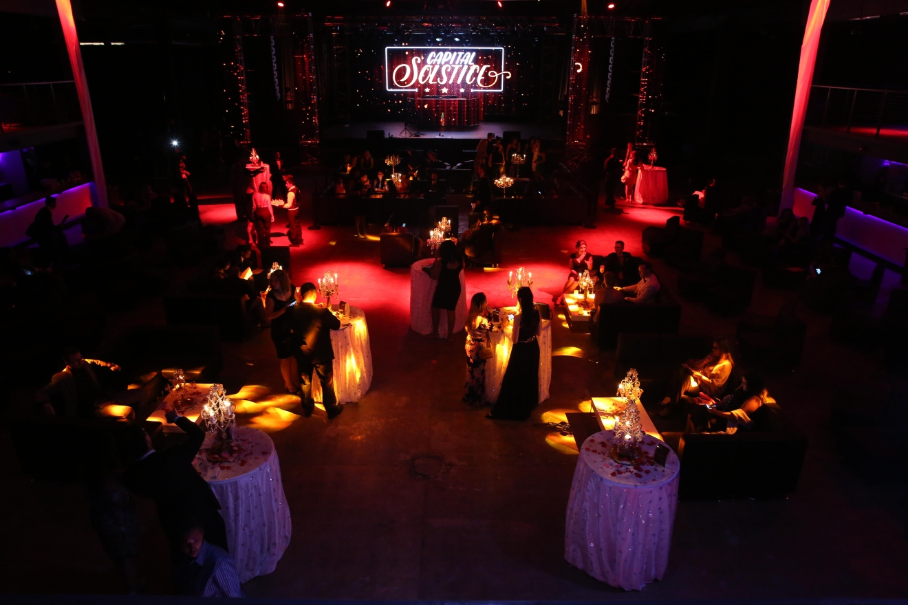 Socially savvy Washingtonians gathered for a Capital Solstice's pop-up gala on August 5. Although the location was only announced two days before the main event, the black-tie gala featured a fashion show and multi-course meal. (Amanda Andrade-Rhoades/DC Refined)