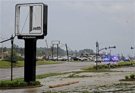 Buildings are damaged along Gloucester Street after a tornado in Tupelo, Miss., Monday, April 28, 2014.