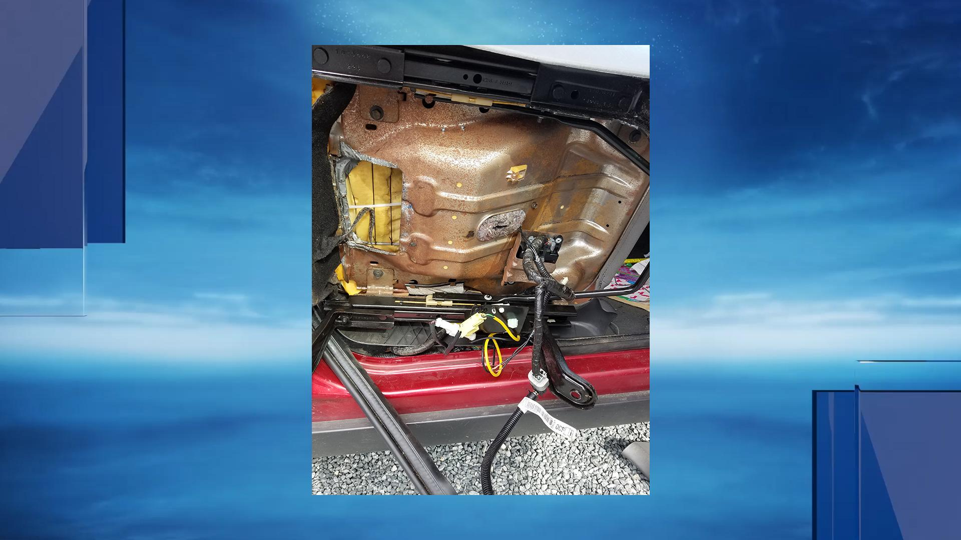 Portsmouth police arrested a woman they say was hiding drugs in the compartment of a car. (Portsmouth Police Department)