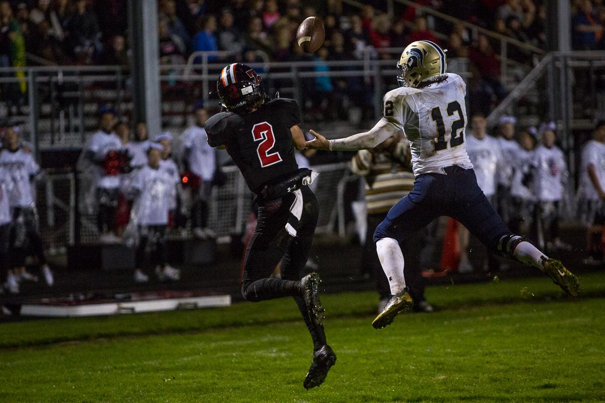 Thurston Colt D.J. Stedman (#2) and Marist Spartan Mitchell Hopkins (#12) compete for the ball. The Thurston Colts defeated the Marist Catholic Spartans 50 – 14 to seal second place in their conference at Thurston High School on Friday, October 13. Photo by Kit MacAvoy, Oregon News Lab
