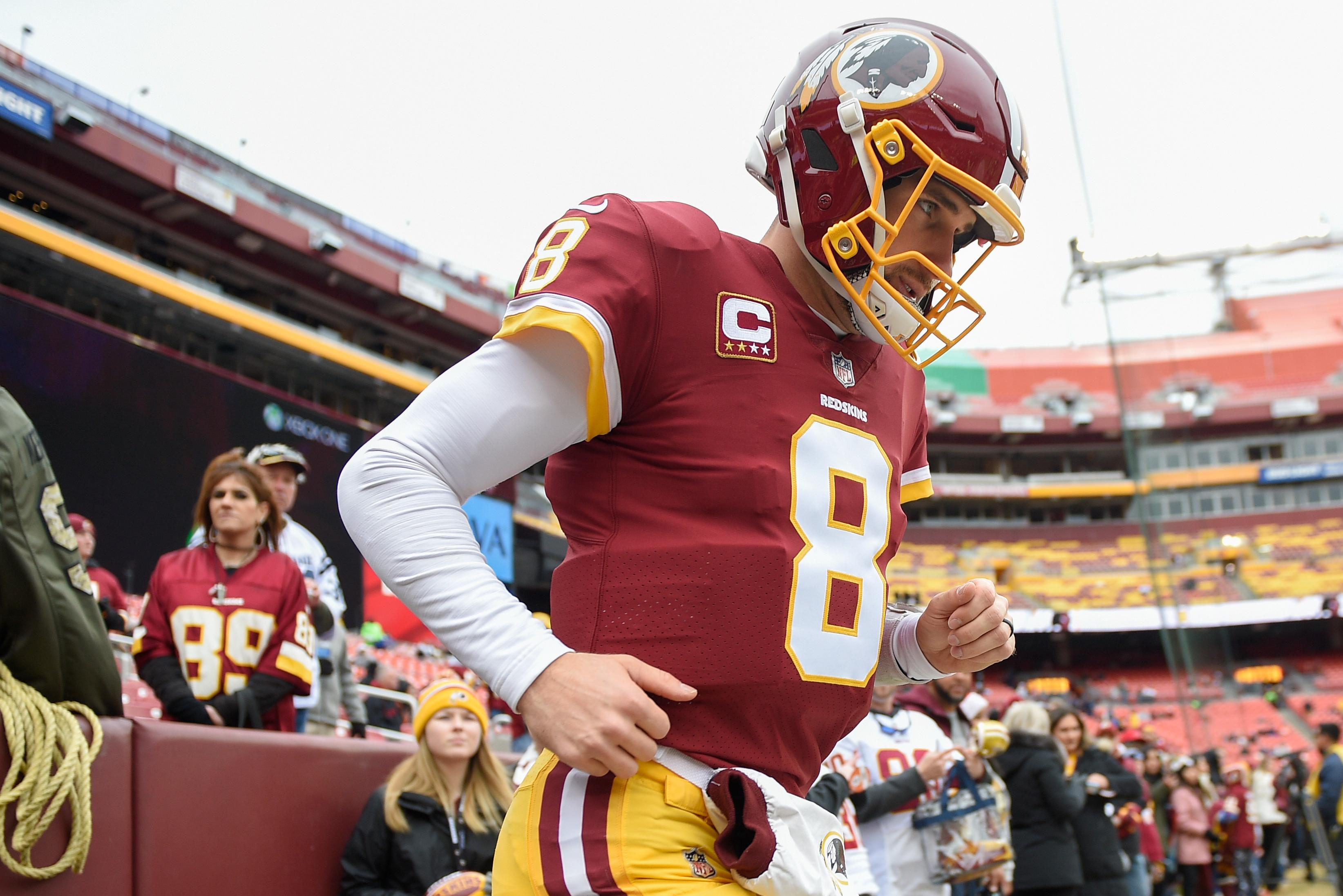 Washington Redskins quarterback Kirk Cousins (8) runs onto the field to warm up before an NFL football game against the Denver Broncos in Landover, Md., Sunday, Dec 24, 2017. (AP Photo/Nick Wass)