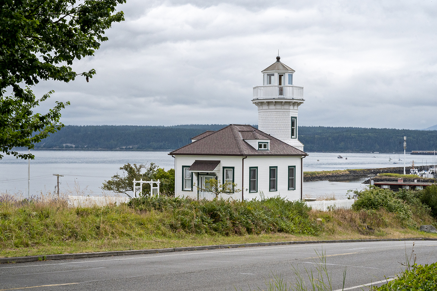 Built in 1990, the Dimick Lighthouse was built as a Victorian-style vacation home for the Dimick family and features a 50-foot tower that overlooks the ferry landing. (Image: Rachael Jones / Seattle Refined)