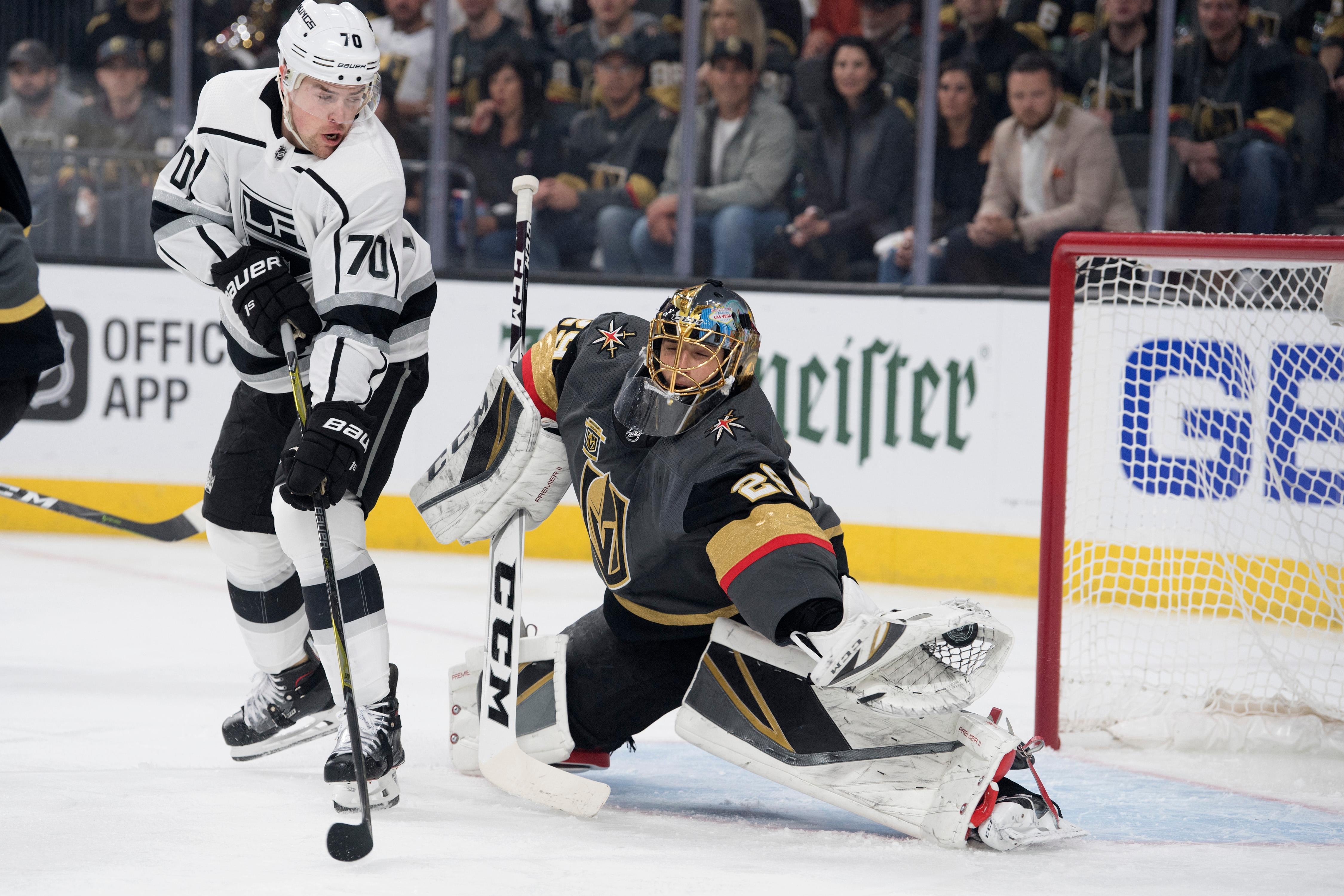 Vegas Golden Knights goaltender Marc-Andre Fleury (29) makes a glove save while Los Angeles Kings left wing Tanner Pearson (70) waits for a rebound during the first period of Game 1 of their NHL hockey first-round playoff series Wednesday, April 11, 2018 at T-Mobile Arena. The Knights won 1-0. CREDIT: Sam Morris/Las Vegas News Bureau