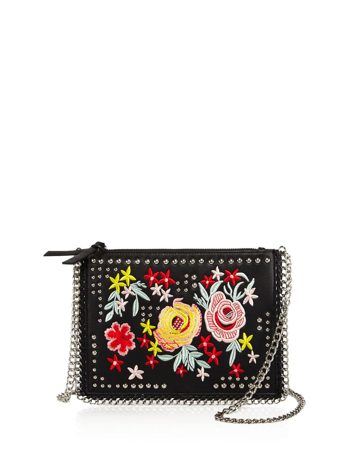 Sunset &amp;amp; Spring Floral Crossbody at Bloomingdale's // Price: $65.00 // (Image: Bloomingdale's // bloomingdales.com)<p></p>