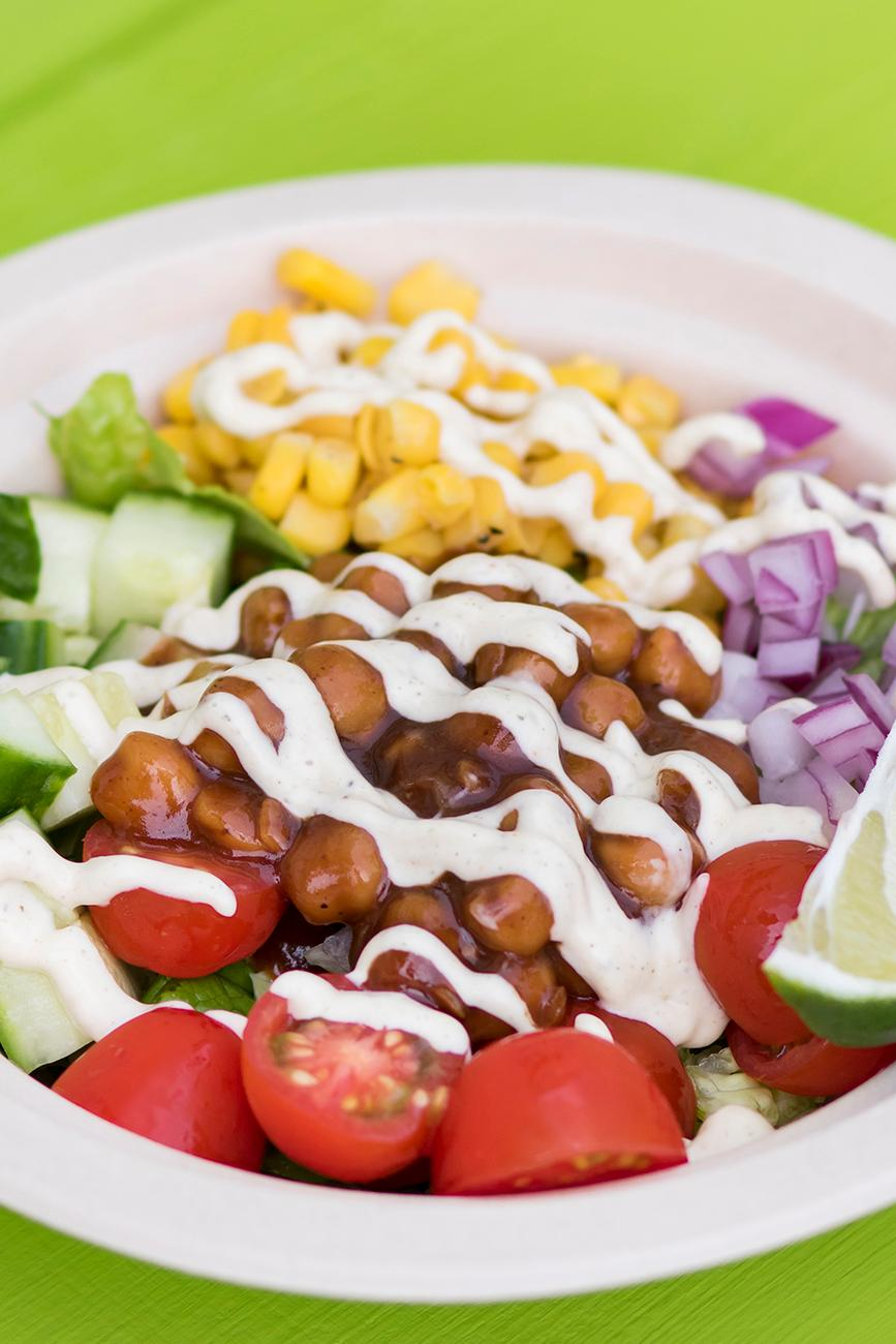 BBQ Banzo Bowl: chickpeas smothered in bbq sauce, tomatoes, corn, red onion, and cucumbers served over chopped romaine and drizzled with house-made ranch dressing / Image: Allison McAdams // Published: 6.27.19