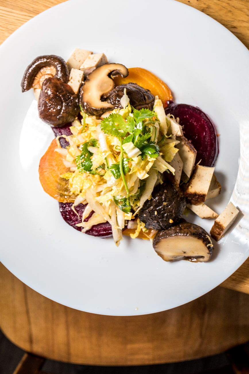 Five spice tofu with pickled shitake mushrooms and roasted beets served over a Napa salad with plum dressing / Image: Catherine Viox{ }// Published: 1.15.20
