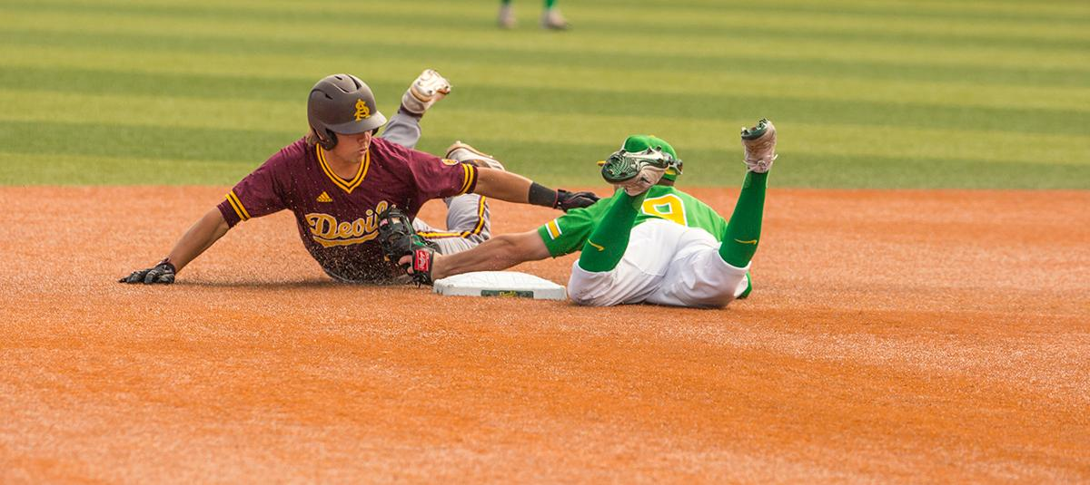 Ducks Infielder Morgan McCullough(#9) tags Sun Devils Andrew Snow(#4) out at second base. Despite a late comeback, the Ducks fall to Arizona State Sun Devils 4-3 in the second game of a three-game series. Photo by James Wegter, Oregon News Lab