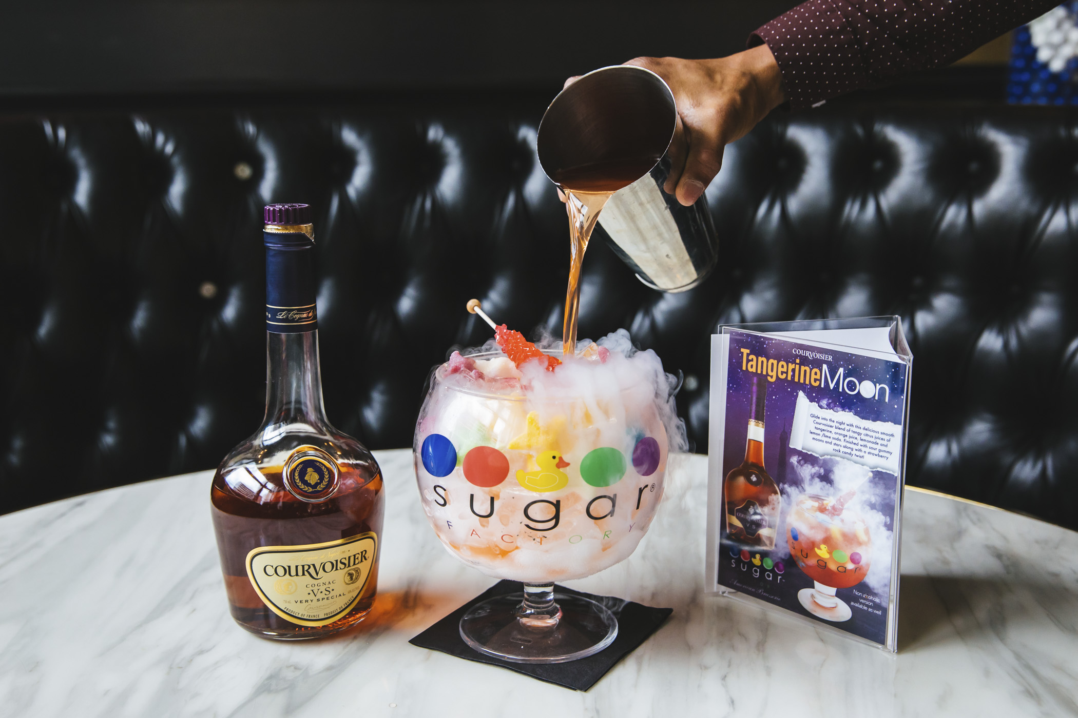 The Sugar Factory has introduced a new Courvoisier Goblet - just in time for National Cognac Day, Tuesday, June 4, 2019! The Tangerine Moon Goblet features a delicious Courvoisier blend of citrus juices of tangerine, orange juice, lemonade and lemon/lime soda. Available now through June 5! (Image: Sunita Martini / Seattle Refined).
